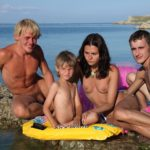 Young families nudists early morning swim